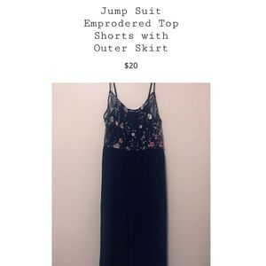 Long Charlotte Russe jump suit with over skirt.